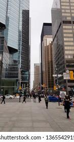 TORONTO, CANADA - APRIL 8, 2019: People walking a Downtown Toronto street.