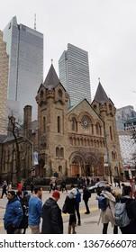 TORONTO, CANADA - APRIL 8, 2019: People walking along King Street in Toronto, Canada.