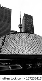 TORONTO, CANADA - APRIL 8, 2019: The Roy Thompson Hall and the CN Tower in Toronto, Canada.