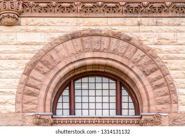 Toronto, Canada, architectural details of the Old City Hall which is a Richardsonian Romanesque Revival architecture made in red sandstone. The building is part of the city heritage.