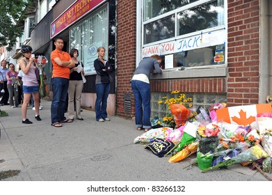 TORONTO, CANADA - AUG 22:  Mourners gather at the constituency of Jack Layton to pay respect to the leader of the NDP, the Canadian opposition party, who died that morning, Aug 22, 2011 in Toronto.