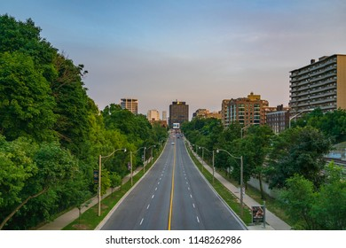 TORONTO, CANADA - AUGUST 02, 2018:   Yonge Street - the main street of Toronto, between Davisville and St. Clair Avenues, at sunset, with Mount Pleasant Cemetery on the East