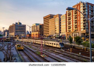 TORONTO, CANADA - AUGUST 02, 2018:  A new  Bombardier  TTC train is departing from Davisville subway station at sunset