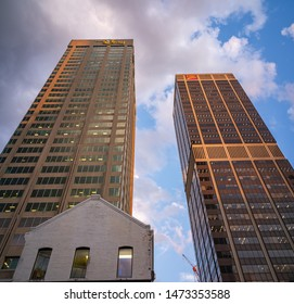 TORONTO, CANADA - AUGUST 06, 2019 : The Bay and CIBC Bank skyscrapers buildings at Yonge street and Bloor Street  in Toronto from below