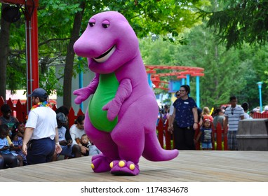 Toronto, Canada - August 1, 2018: Barney performing  on stage at Canada's Wonderland.
