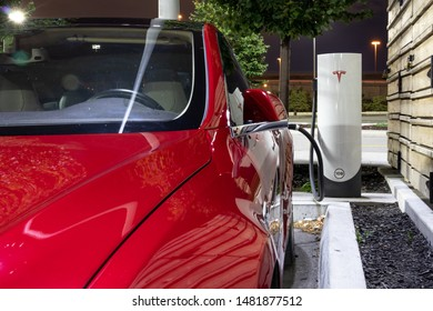 TORONTO, CANADA - August 15, 2019: Tesla Model S plugged-in at Tesla Supercharger