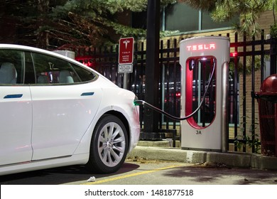 TORONTO, CANADA - August 15, 2019: New Tesla Model S at Tesla Dealership plugged-in and supercharging late at night.