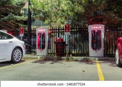 TORONTO, CANADA - August 15, 2019: New Tesla Model S supercharging late at night at Tesla Dealership in Toronto.