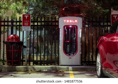 TORONTO, CANADA - August 15, 2019: Tesla Model S parked at Tesla Supercharger at night.