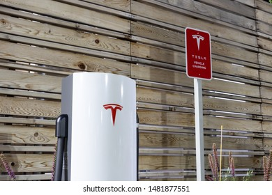 TORONTO, CANADA - August 15, 2019: Tesla Urban Supercharger glistening at night.