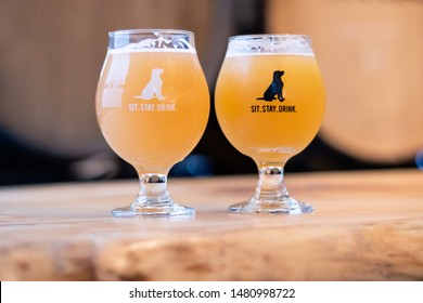 Toronto, Canada - August 2, 2019 : Two glasses of beer at the dog friendly Black Lab Brewing micro brewery.