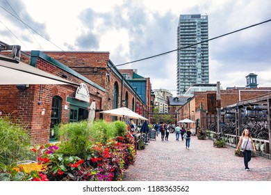 TORONTO, CANADA - AUGUST 24, 2017: Distillery District (former Gooderham &Worts Distillery) - historic and entertainment precinct. It contains numerous cafes, restaurants, shops and industrial parts.