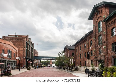 TORONTO, CANADA - AUGUST 24, 2017: Distillery District (former Gooderham & Worts Distillery) - historic and entertainment precinct. It contains numerous cafes, restaurants, shops and industrial parts.