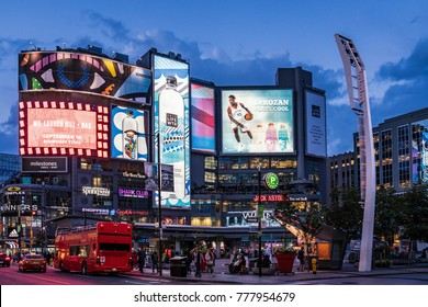 TORONTO, CANADA - AUGUST 25 , 2017:   Billboards displays on buildings at Dundas Square illuminated at night