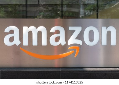 Toronto, Canada - August 5, 2018: The Amazon logo in a building in the downtown district. Amazon is the second company in arriving at a trillion dollars market value (after Apple)