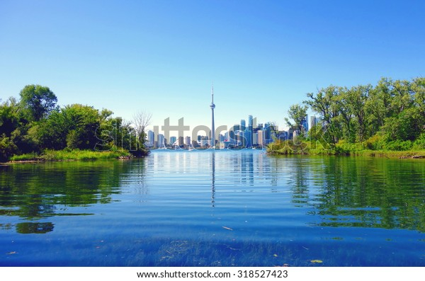 TORONTO, CANADA - AUGUST 9, 2015: A view of the CN Tower and the skyline from the Toronto Island, Canada.