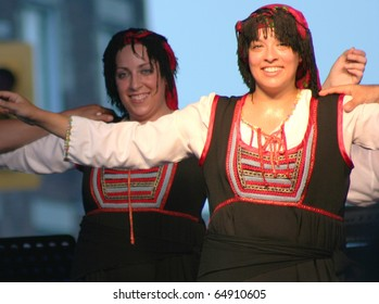 TORONTO, CANADA - AUGUST 9: Unidentified dancers at an annual Greek festival in Toronto, Canada on August 9, 2009.  The Taste of the Danforth festival takes place every August in Toronto