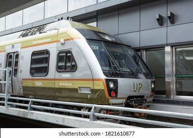 Toronto, Canada, Circa 2015; A Metrolinx Union Pearson UP Express commuter waiting at Pearson International Airport terminal heading to Union Station in downtown Toronto