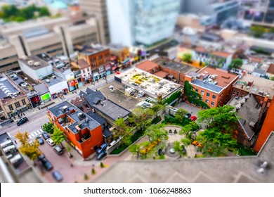 Toronto, Canada -Circa October 2016: Interesting, miniature diorama effect seen from a tall vantage point of the Toronto city centre. Showing the various building designs and streets below.