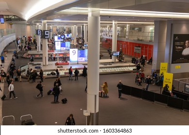 TORONTO, CANADA - December 13, 2019: Passengers at baggage claim carousels inside Toronto Pearson Intl. Airport during the Christmas season.