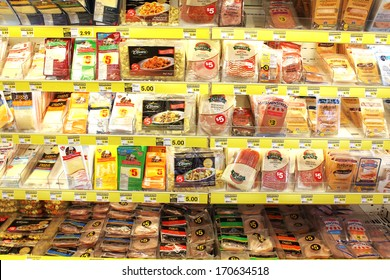 TORONTO, CANADA - DECEMBER 18, 2013: Variety of processed meats and prepacked foods in a grocery store. North America is one of the leading consumers of processed meats in the world.