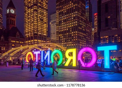 Toronto, Canada- December 20, 2017: The three dimensional Toronto Sign lit at night in the Nathan Phillips Square. The downtown place is a famous place and tourist attraction