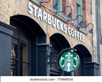 TORONTO, CANADA - DECEMBER 21, 2016: Starbucks logo on a Starbucks cafe in the city center of Toronto, Ontario. The brand is one of the leaders in coffee service in Canada and worldwide