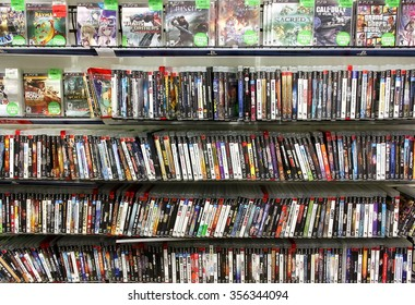 TORONTO, CANADA - DECEMBER 24, 2014: Video games on display in a game store in Toronto, Ontario, Canada.