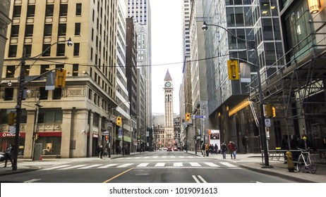 TORONTO CANADA - FEB 2017: Downtown Toronto with view of tall modern buildings and Old City Hall with tower clock.  Old City Hall was declared a National Historic Site by the Historic Sites and Monume