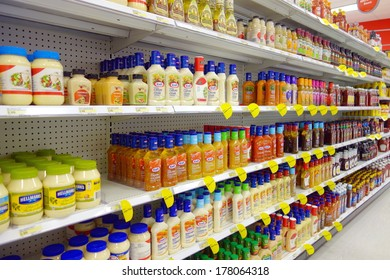 TORONTO, CANADA - FEBRUARY 11, 2014: Salad dressings selection in a supermarket shelf in Toronto, Canada.