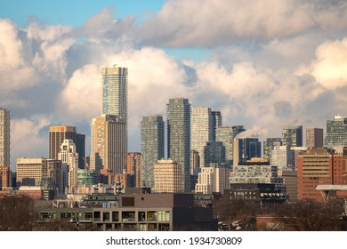 Toronto, Canada - February 20, 2021 : Early afternoon light illuminating clouds over the Toronto skyline with One Bloor tower and Manulife Centre