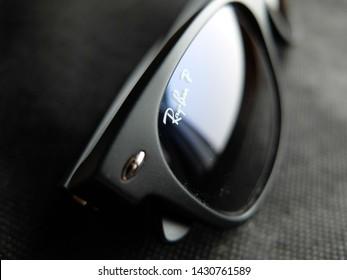 TORONTO / CANADA - FEBRUARY 9, 2014: Ray-Ban New Wayfarer polarized sunglasses close-up, emphasizing the logo