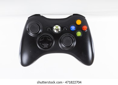 TORONTO, CANADA - FEBRUARY 9, 2016 : Black XBOX Gaming Console handheld wireless controller for video gaming, shown in an illustrative editorial on bright background