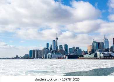 TORONTO, CANADA - FEBRUARY 9, 2019: Toronto city skyline with an icy Lake Ontario in-front.
