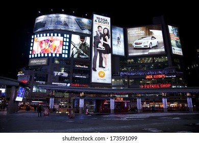 TORONTO, CANADA - JANUARY 17, 2014: Yonge and Dundas square in Toronto at night, showing many colourful neon billboards with advertisements on January 17, 2014