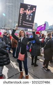 TORONTO, CANADA - JANUARY 20, 2018: PROTESTERS WITH SIGNS AT WOMEN'S MARCH ON TORONTO: DEFINING OUR FUTURE.