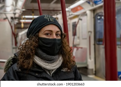 TORONTO, CANADA - JANUARY 23, 2021: PERSON WEARS FACE MASK ON TTC SUBWAY DURING COVID-19 PANDEMIC.