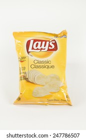 Toronto, Canada - January 27 2015 : Small Foil Bag of Lay's Brand Original Flavor Potato Chips shown on a bright background
