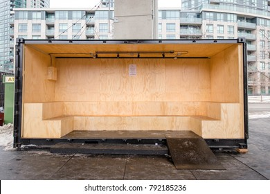 TORONTO, CANADA - JANUARY 9, 2017:  REPURPOSED CRATE NOW USED A PLACE TO SIT SND CHANGE SKATES AT THE BENTWAY SKATING RINK UNDER THE GARDINER EXPRESSWAY.