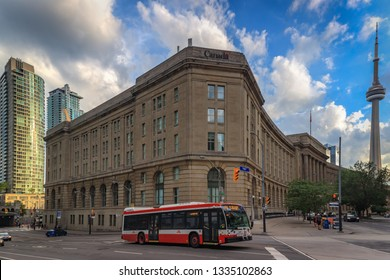 TORONTO, CANADA - JULY 02, 2018:  Facade of Government of Canada Building and a TTC bus in the Financial District of Downtown Toronto