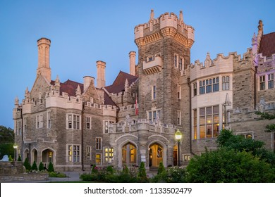TORONTO, CANADA - JULY 07 , 2018: Casa Loma Castle on a warm summer evening at sunset with a blue clear sky in the background