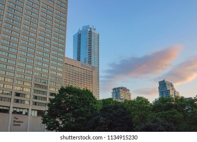 TORONTO, CANADA - JULY 13 , 2018:The Sheraton Centre and Hilton Hotels, one beside the other, in  Downtown Toronto at sunset