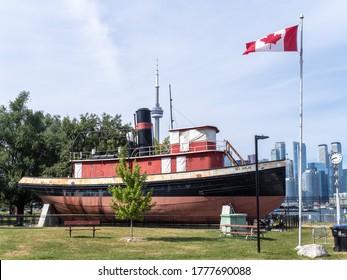 Toronto, Canada, July 15, 2020; The old 1920's era tugboat Ned Hanlan on display on land on Hanlan's Point on Toronto Island.