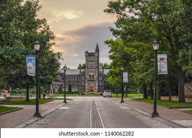 TORONTO, CANADA - JULY 21, 2018:  University Of Torono - King's College Road and a campus police wehicle on a duty , at sunset
