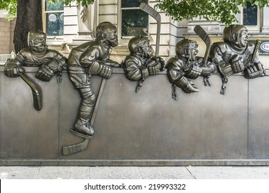 TORONTO, CANADA - JULY 23, 2014: Sculptures in front of the Hockey Hall of Fame. Hockey Hall dedicated to history of ice hockey, exhibits about players, teams, NHL records, memorabilia and trophies.
