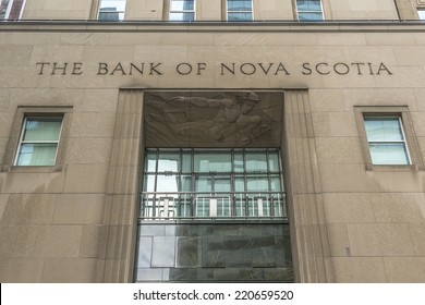 TORONTO, CANADA - JULY 23, 2014: Historic Beaux-Arts headquarters of Bank of Nova Scotia (Scotiabank, 1951), located at 44 King Street West, is on northeast corner of intersection at Bay and King.