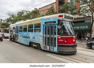 TORONTO, CANADA - JULY 23, 2014: City transportation streetcar. Toronto streetcar system comprises eleven streetcar routes in Toronto, operated by Toronto Transit Commission (TTC).
