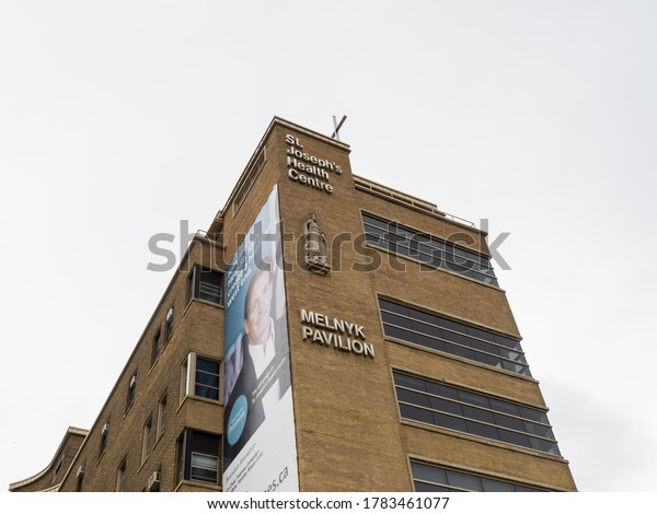 Toronto, Canada, July 23, 2020; The name and the cross and sculpture of the Saint on the St. Joseph's Health Centre Catholic hospital in Toronto