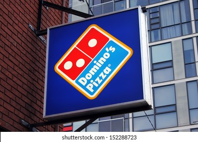 TORONTO, CANADA - JULY 23: Domino's Pizza restaurant sign on July 23, 2013 in Toronto, Ontario, Canada. Domino's Pizza is the second largest pizza chain in the United States and the largest worldwide.