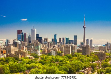 TORONTO, CANADA - JULY 24, 2013: Beautiful summer sunny day panorama of Toronto downtown skyline with CN Tower